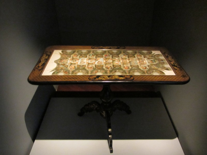 Antique table depicting the Sistine Chapel. Photo credit: Kimberlee Córdova
