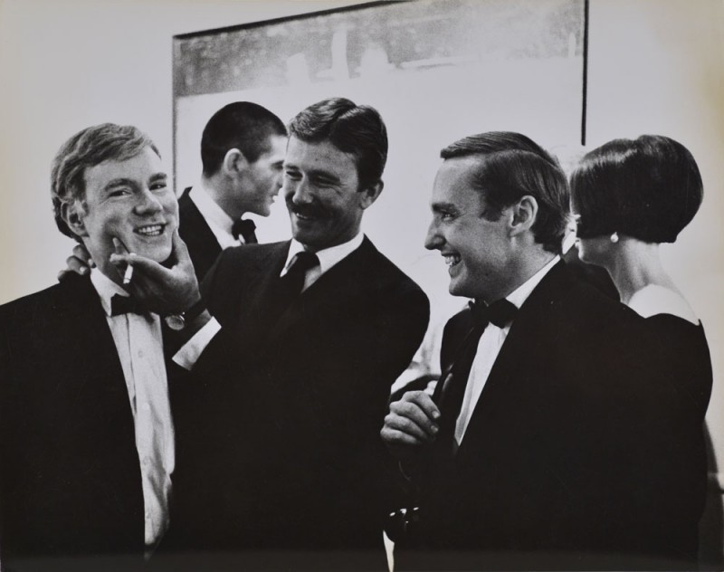 "Julian Wasser. ""Andy Warhol, Irving Blum, Billy Al Bengston and Dennis Hopper, at the Opening Reception, Duchamp Retrospective, Pasadena art Museum, 1963. Vintage gelatin silver print. 7.5 x 9.5"". Courtesy Robert Berman Gallery"