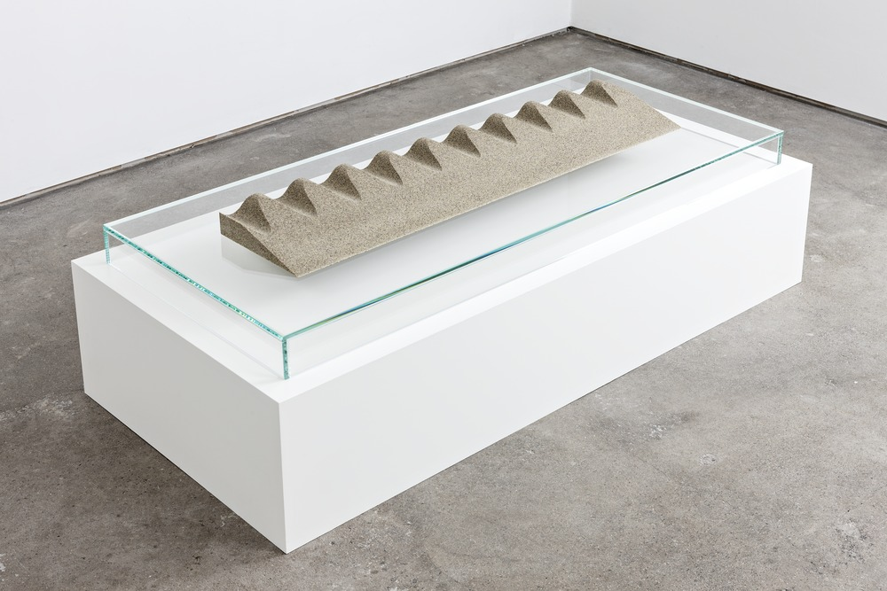 Slice/Wave Fulgurite III.I, 2013. Sand, granite, glass, resin, opal and garnet, cast at Factice. Glass and spray-lacquered wooden plinth. 2.375 x 42 x 9.75 inches. Courtesy of Standard (Oslo). Photograph by Vegard Kleven.