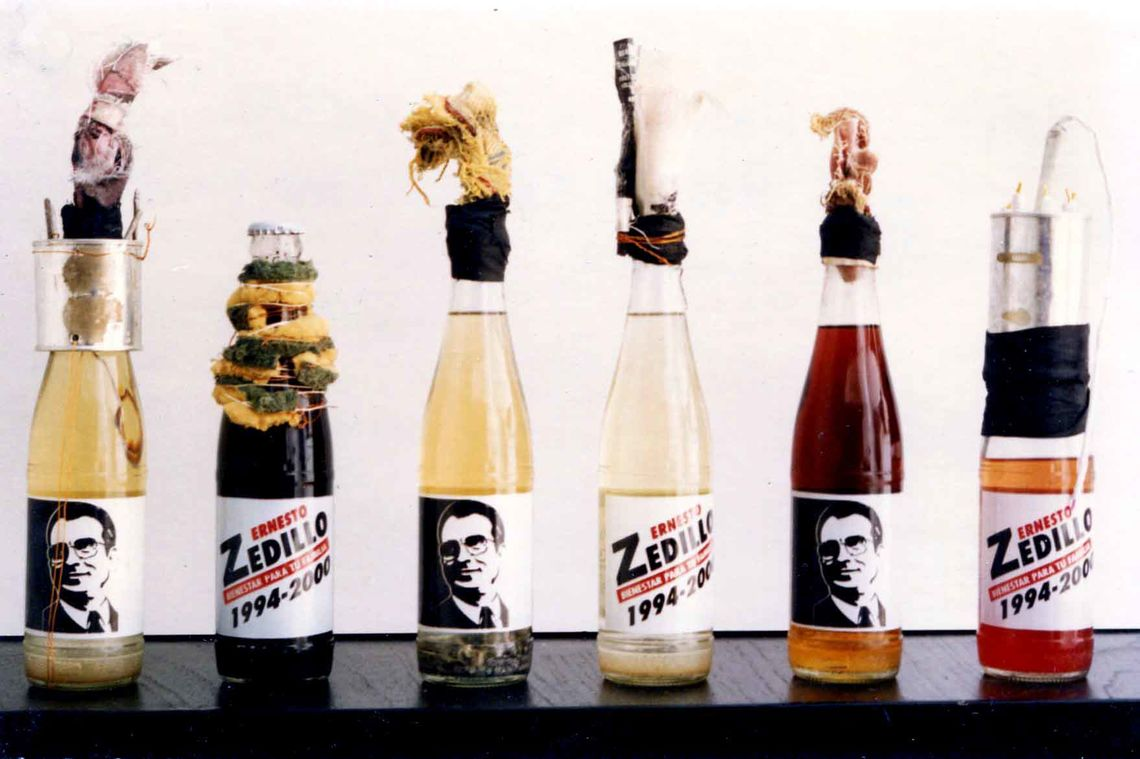 Vicente Razo, Revolucionario institucional (Institutional Revolutionary), 1994. Molotov cocktails in six propaganda glass bottles and mixed media, dimensions variable. Courtesy of the artist and Moore College of Art & Design.