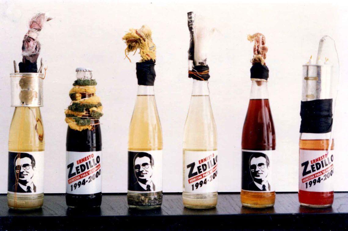Vicente Razo, Revolucionario institucional (Institutional Revolutionary), 1994. Molotov cocktails in six propaganda glass bottles and mixed media, dimensions variable. Courtesy of the artist and Moore College of Art & Design.