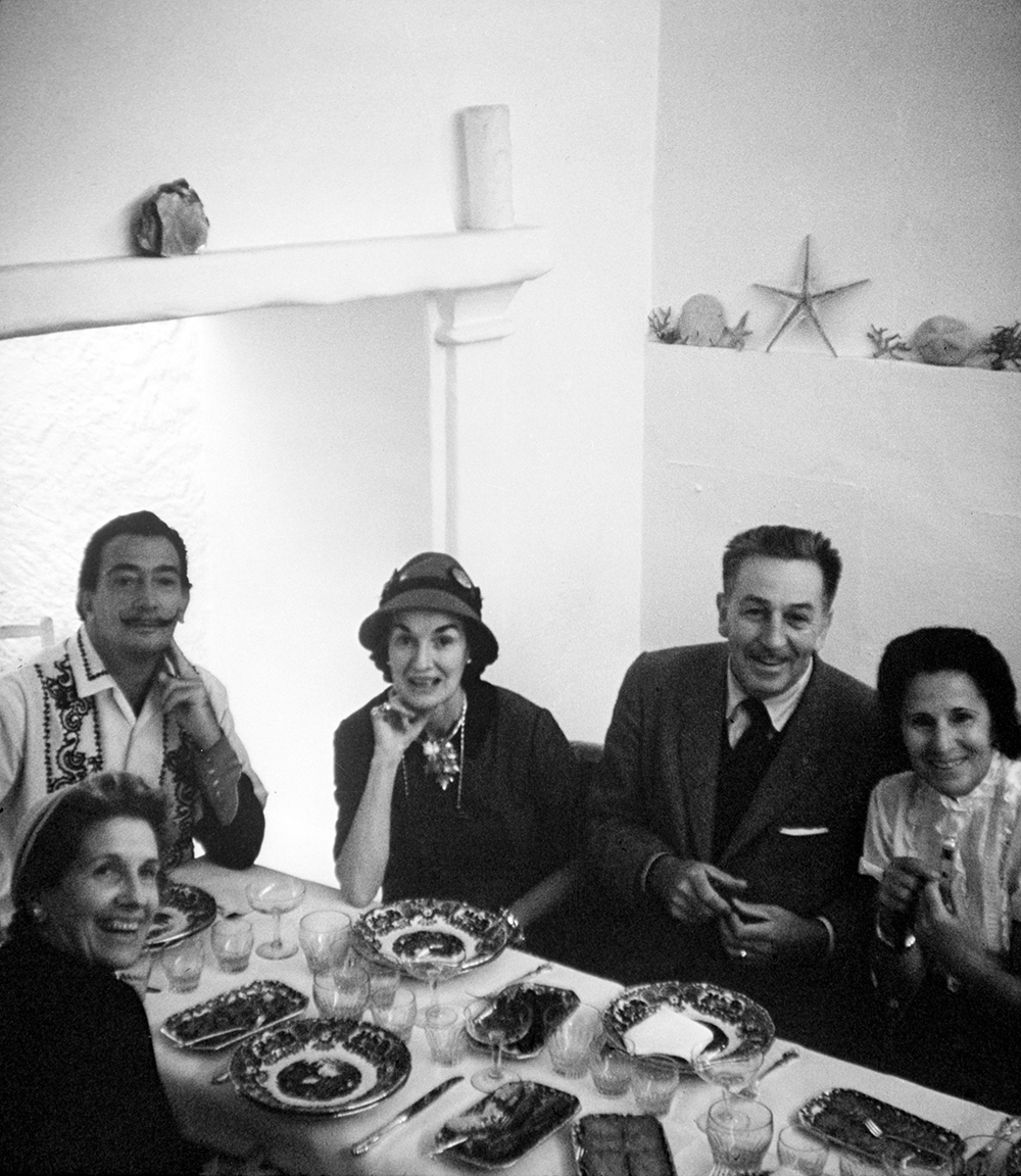 The Dalí and Disney families around the dinner table in Spain, 1957. Courtesy of The Walt Disney Company, © Disney.