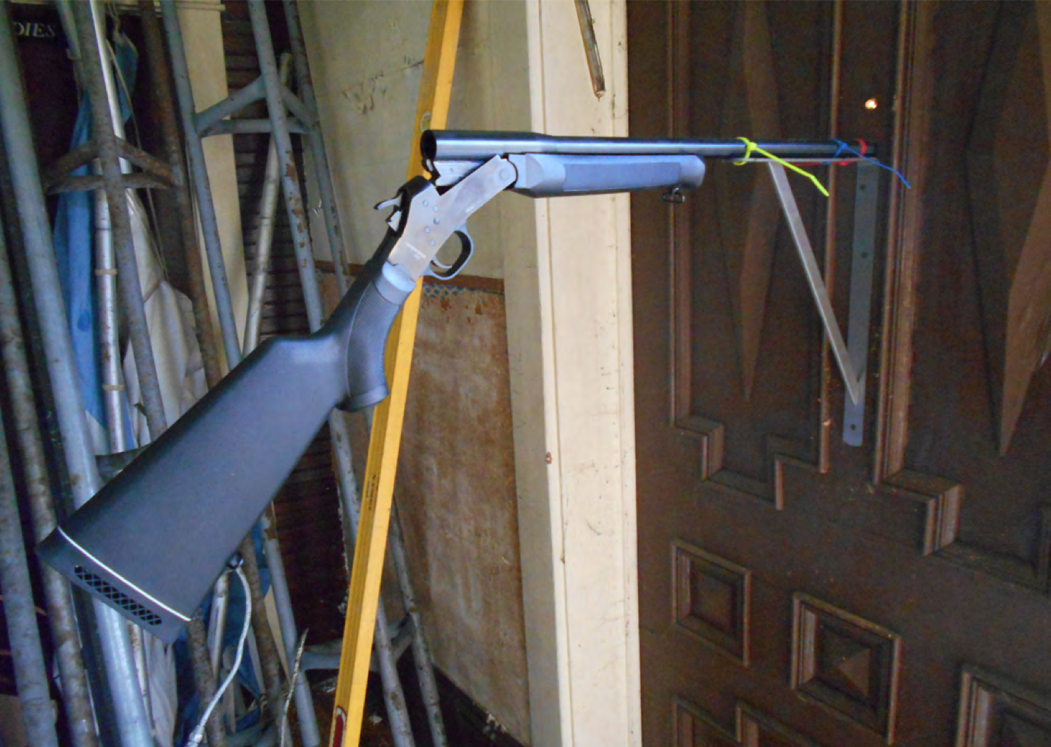 POINT BLANK, 2014. 12 gauge shotgun installed in shut door. Courtesy of the artist.