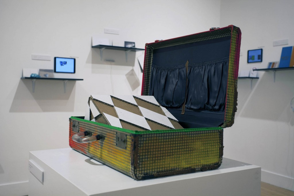 "Nile Sunset Annex. ""An Artwork by Nile Sunset Annex,"" 2015. Suitcase, cardboard, paint, 20.5 inches high. Photo courtesy Nile Sunset Annex/Haines Gallery."