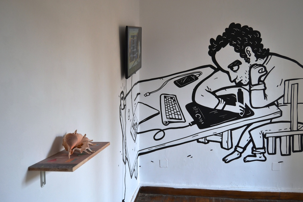 """Overview of """"New Folder 2,"""" a collaborative exhibition at Nile Sunset Annex by Kareem Lofty and Andeel, vinyl, video, printed shelf, shell, 2015."""