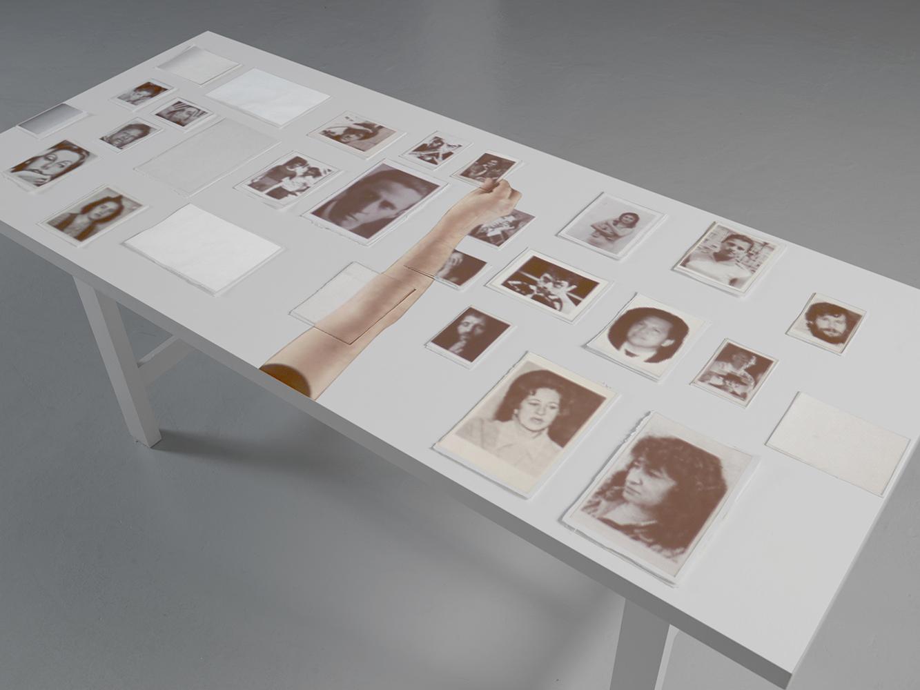 Oscar Muñoz, Editor Solitario, 2011. Video Blu-Ray Projection on a table, 36.19 min loop. Collection of Museo de Arte del Banco de la República