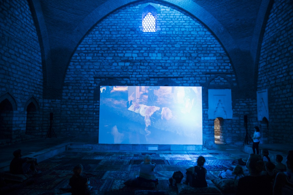 Wael Shawky, Cabaret Crusades: The Secret of Karbala, 2015. Installation with projection in HD video, liquid tar, clay, cement, wool, marble, and hand blown Murano glass marionettes. Photograph by Ilgun Erarslan Yanmaz. Courtesy of IKSV.