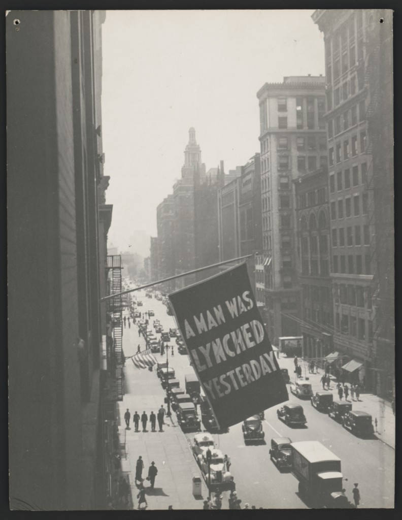 Flag, announcing lynching, flown from the window of the NAACP headquarters on 69 Fifth Ave., New York City, 1936. Photograph, 13 7/16 x 10 7/16 inches. Prints and Photographs Division, Library of Congress, Washington, D.C, LC-DIG-ppmsca-39304. Courtesy of The Crisis Publishing Co., Inc., the publisher of the magazine of the National Association for the Advancement of Colored People, for material first published in The Crisis. Courtesy of the Brooklyn Museum.
