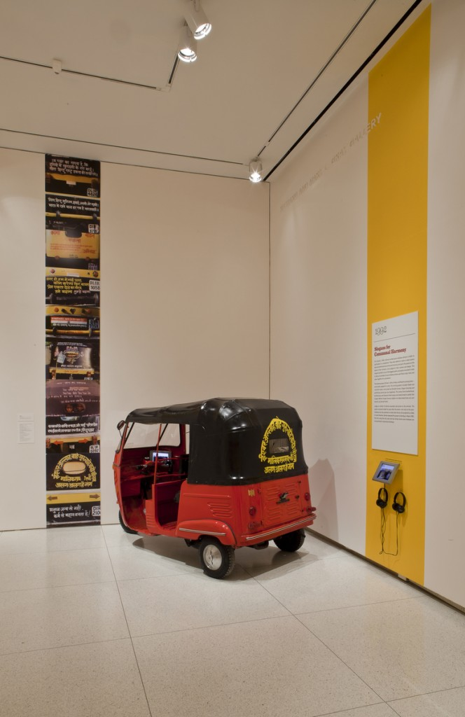 SAHMAT [Safdar Hashmi Memorial Trust] (founded 1989), Slogans for Communal Harmony (Auto-rickshaw project), 1992/2013. Rickshaw, steel with vinyl top; documentary photographs and video; rickshaw: 65 1/2 × 50 1/2 × 108 inches, cover: 30 1/2 × 45 × 60 1/2 inches. The David and Alfred Smart Museum of Art, The University of Chicago. (Photo: © 2015 courtesy of The David and Alfred Smart Museum of Art, The University of Chicago.) Courtesy of the Brooklyn Museum.
