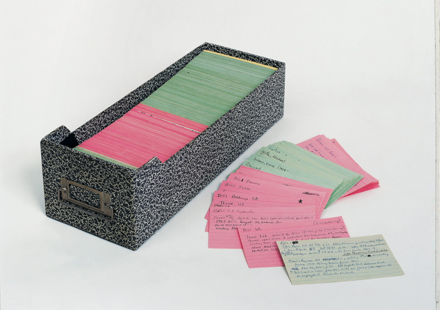 Mark Lombardi's index cards, with notes from his research on the activities of individuals and groups implicated in the financial scandals he was investigating, 1998-2001. Photograph by John Berens. Courtesy of Donald Lombardi and Pierogi Gallery.