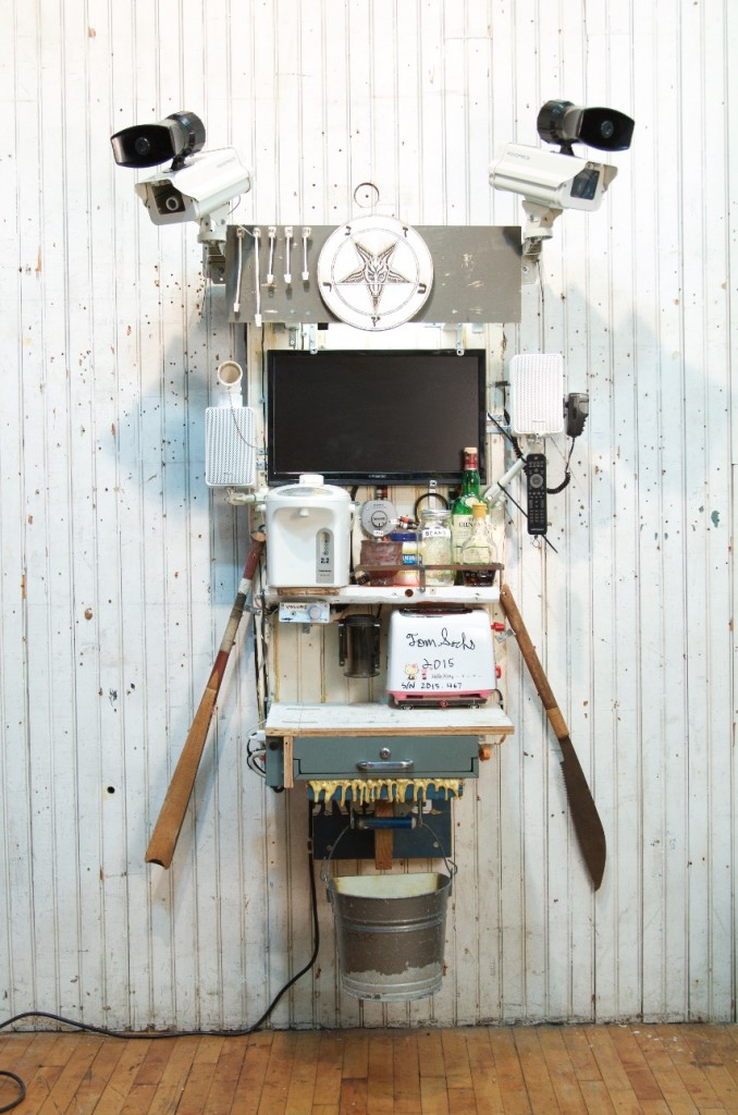 Tom Sachs, Breakfast, 2016. Wood, steel, stoneware, porcelain, toaster, tv, pirated DVDs, water boiler, coffee, sugar, maple syrup, whiskey, stereo amplifier, speakers, surveillance cameras, loudspeaker, epoxy resin and fiberglass. 70 x 42 x 30 inches.