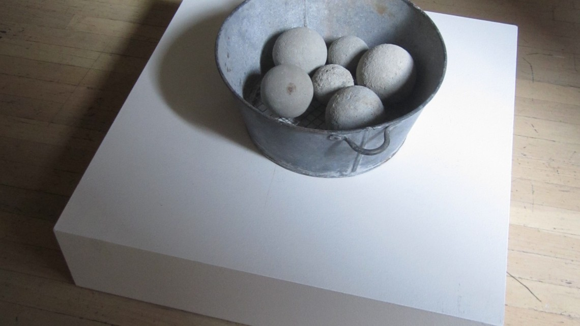 "David Ireland, Untitled (metal colander bowl with 6 dumbballs), (installation view), n.d. found metal and cement, 6""h x 13 3/4"" diameter. Photo: LLutz, courtesy Anglim Gilbert Gallery."