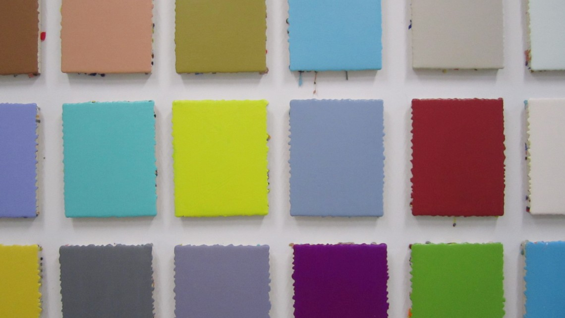 """Leah Rosenberg, 100 Days of Color (from #CHROMAHA), (detail) 2015. Acrylic paint, 100 panels, 10"""" x 8"""" each, installation, 62"""" x 233."""" Courtesy of the artist and Black and White Projects. Photo: LLutz"""