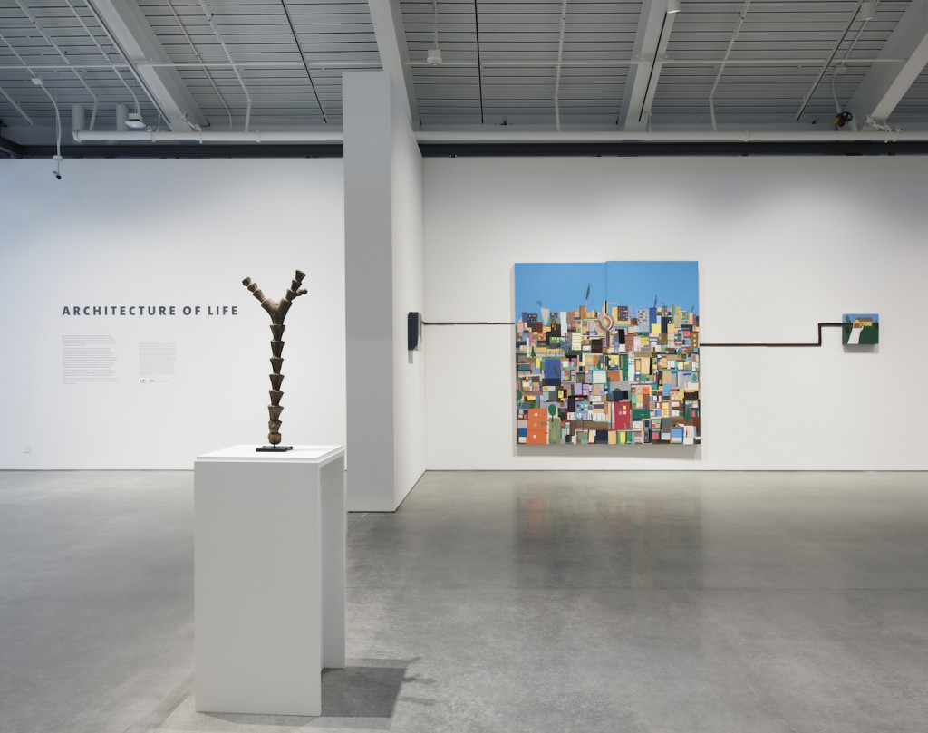 Architecture of Life, on view at the University of California, Berkeley Art Museum and Pacific Film Archive, January 31–May 29, 2016. Installation view, with a Dogon ritual altar ladder (left) and a work by Chris Johanson (right). Photograph by Sibila Savage. Courtesy of UC Berkeley Art Museum and Pacific Film Archive (BAMPFA).