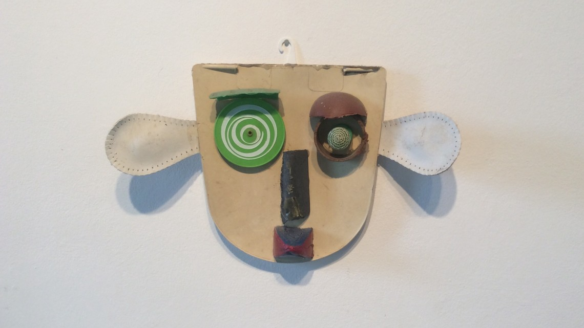 Jerry Barrish, Mask: Dog, 1999. Assemblage, found objects,11x16x2 ¼ inches. Photo credit: John Held, Jr.