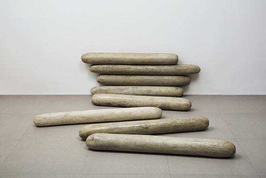 Anna Maria Maiolino, São 8 [They Are 8], 1993. Moulded cement, 39 3/8 x 49 1/4 x 5 1/8 inches. © Anna Maria Maiolino. Photograph by Everton Ballardin. Courtesy of the artist and Hauser Wirth & Schimmel.
