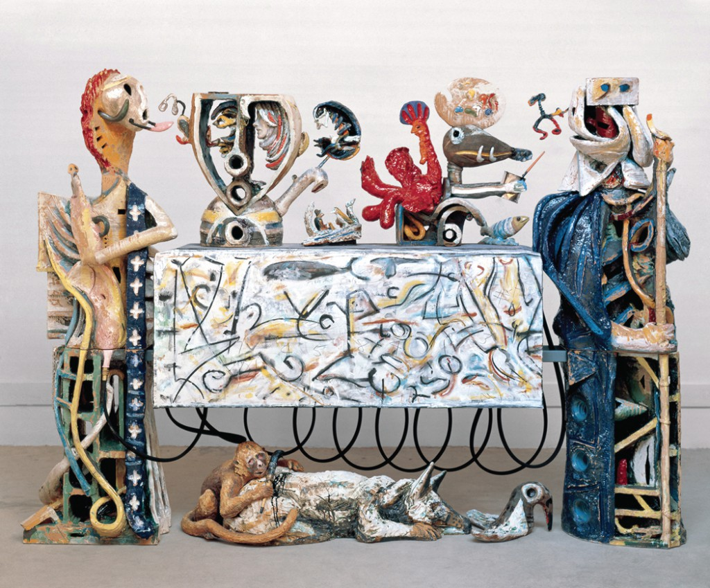 Robert Arneson, Guardians of the Secret II (Front View), 1989-1990. Glazed ceramic, wood, plexiglass, steel, canvas, epoxy, and mixed media, 86 x 119 x 26 inches.
