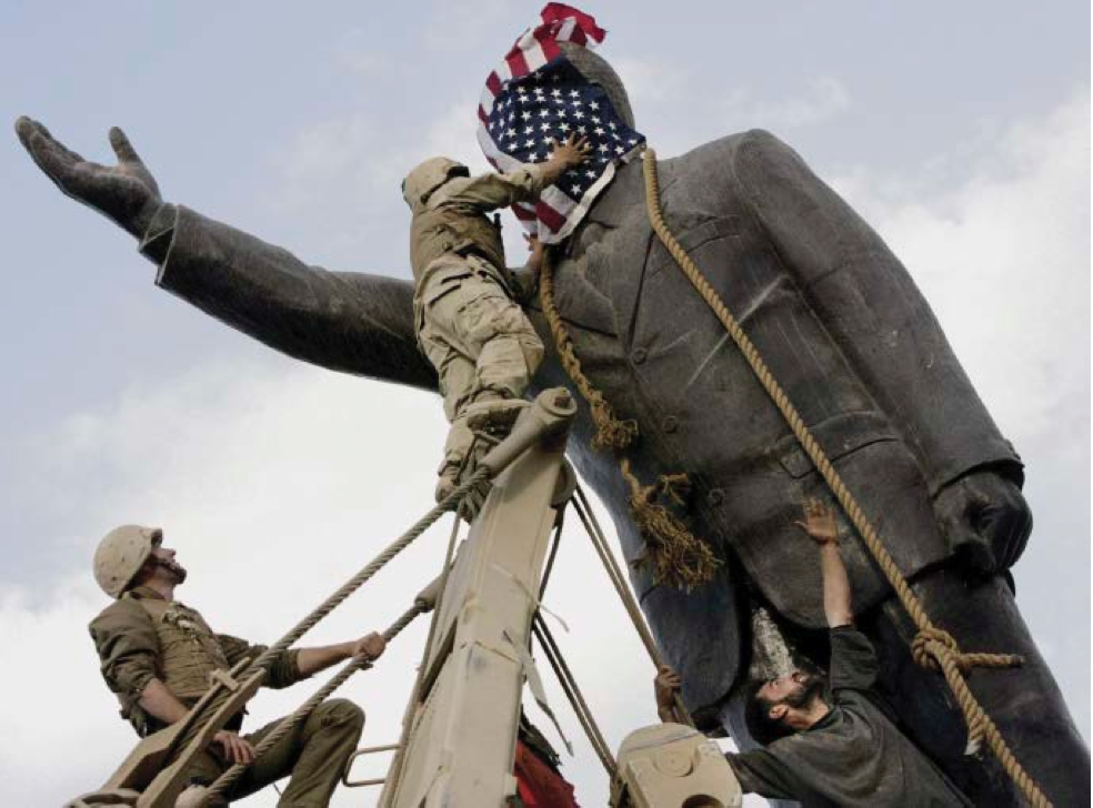 A statue of Saddam Hussein being toppled in Firdos Square, downtown Baghdad, on 9 April 2003.