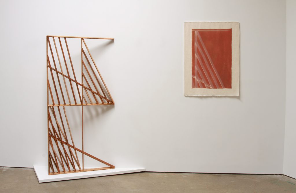 "Andy Vogt,Left: Shadeshape 3, 2011. Salvaged wood lath, 71"" x 34"" x 1.5"". Right: Untitled (02012016 red + green), 2016. Light oxidized pigment on cotton, 37"" X 27.75""."