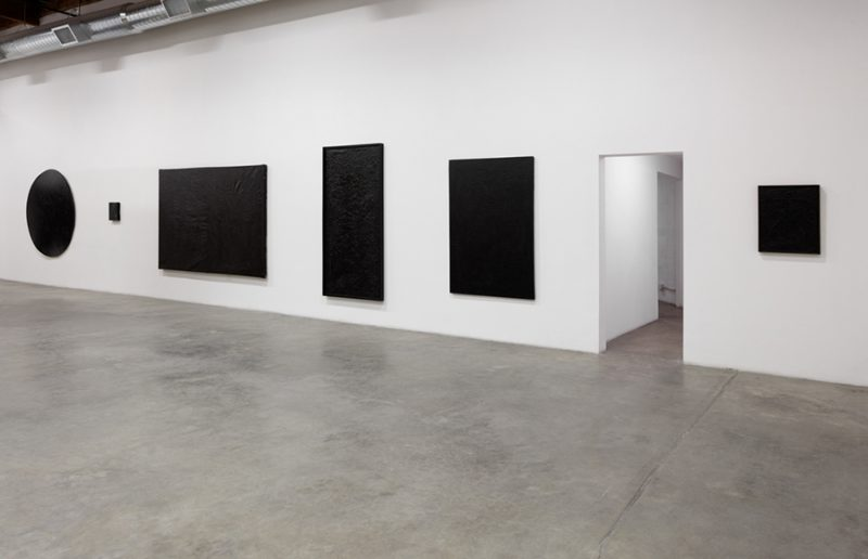 Installation view, The Absence of Light: Black Paintings (1957-2003), Wally Hedrick at The Box, Los Angeles, 2016. Courtesy of The Box.
