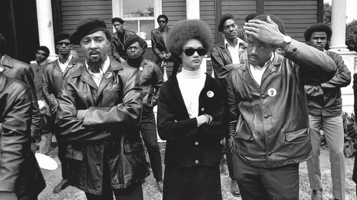 "Kathleen Cleaver and Black Panther co-founder Bobby Seale (right) at a ""Free Huey"" rally in Oakland, California in the summer of 1968. Photograph by Howard Bingham. Courtesy of the Internet."