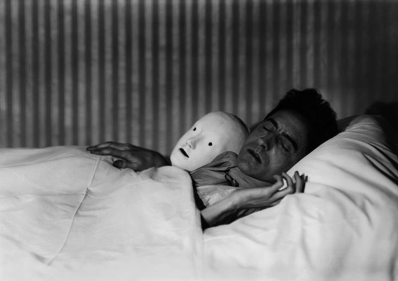 Berenice Abbott, Cocteau in Bed with Mask, Paris, 1927. Gelatin silver print, 10.5 x 13.5 inches. Courtesy of Cheim & Read.