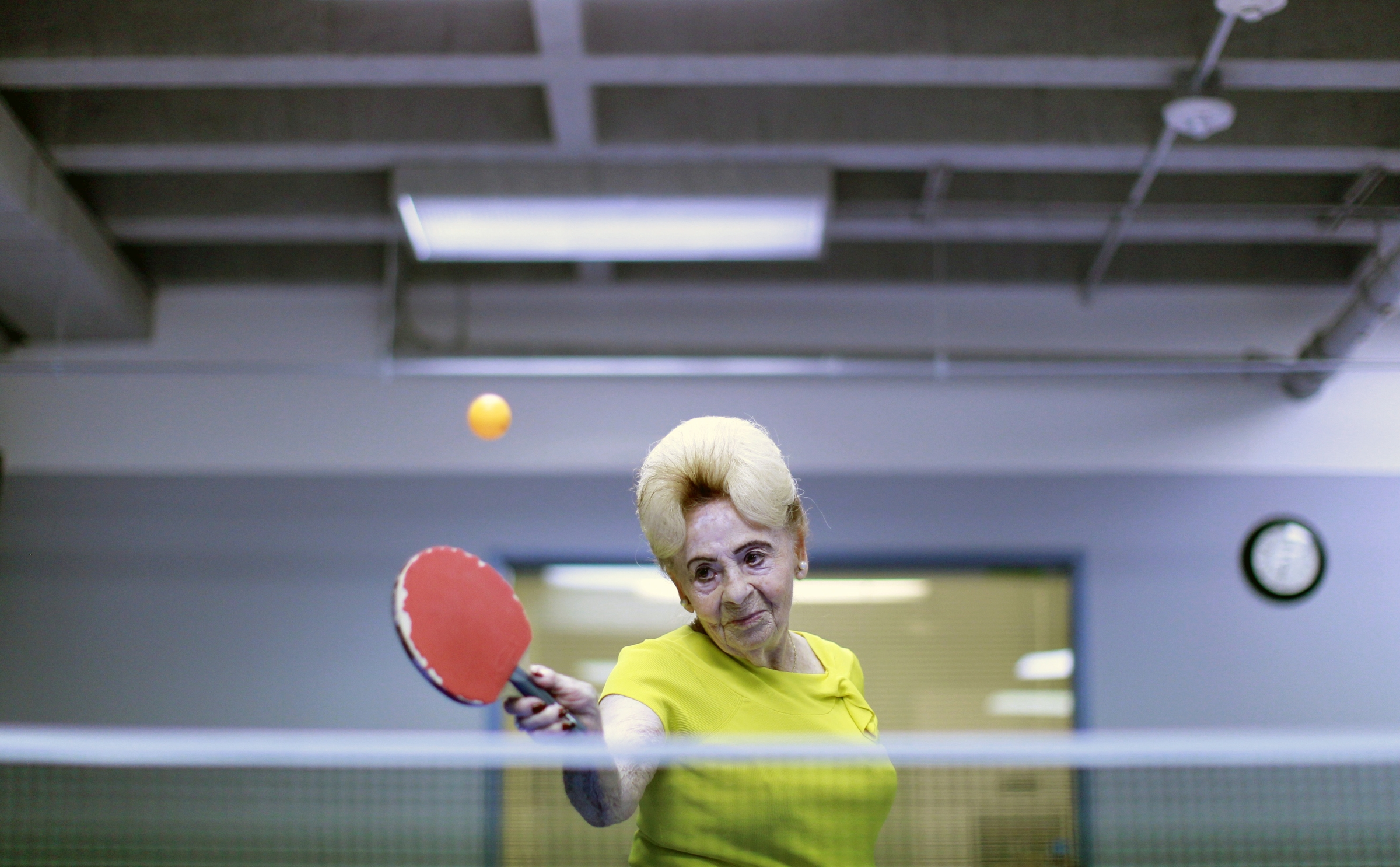 Lucy Nicholson,(American/British, born England), Alzheimer's Ping Pong Therapy, Los Angeles, CA, 2011, printed 2016. Inkjet print, 10 5/8 x 16 3/8 in. Courtesy of Lucy Nicholson/Reuters and the Brooklyn Museum.