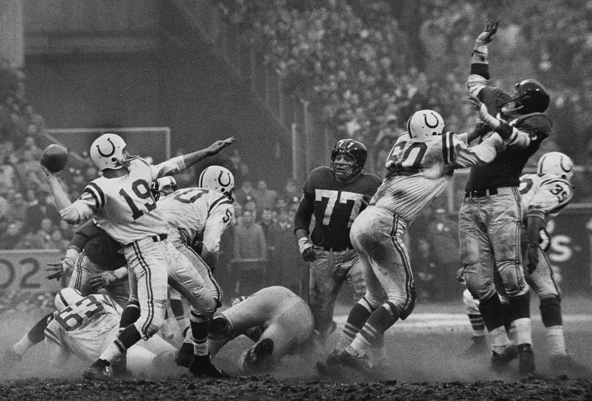 Robert Riger (American, 1924–1995), The Golden Arm, Johnny Unitas, 1958. Gelatin silver print, 12 3/4 x 18 1/4 inches. Collection of the artist. © Robert Riger. Courtesy of the Robert Riger Living Trust and the Brooklyn Museum.