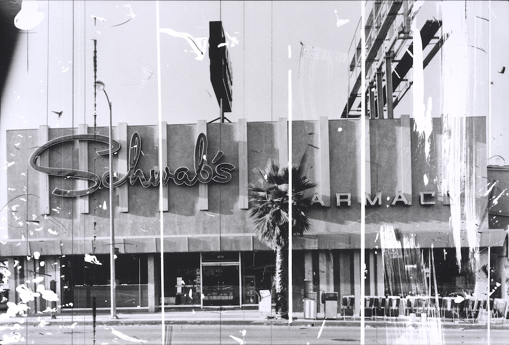 """Ed Ruscha, Schwab's Pharmacy, 1976, from """"The Sunset Strip, series published in 1995. Gelatin silver print from altered negative, 20 x 30 inches. Published by Patrick Painter Editions, Vancouver and Hong Kong. Collection of the Fine Arts Museums of San Francisco. Museum purchase, Mrs. Paul L. Wattis Fund, 2000.131.193 © Ed Ruscha. Courtesy of the Fine Arts Museums of San Francisco."""