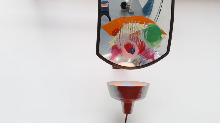 Consolidated (detail), 2016. Driveway mirror, light fixture & bulb, oil paint, plastic, green extension cord, and mounting bracket. © Jessica Stockholder. Courtesy of the artist and Mitchell-Innes & Nash.