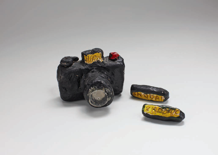 Untitled (Nikon), 1974. Clay and paint, 3 x 2.5 x 2 inches. Courtesy of the artist.