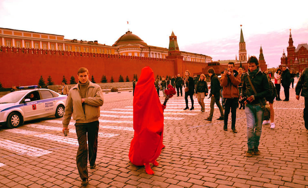 crossing red square, flowers for the earth, 2011. Performance in the Red Square, Moscow. Photograph by Jack Donoghue. Courtesy of the artist.
