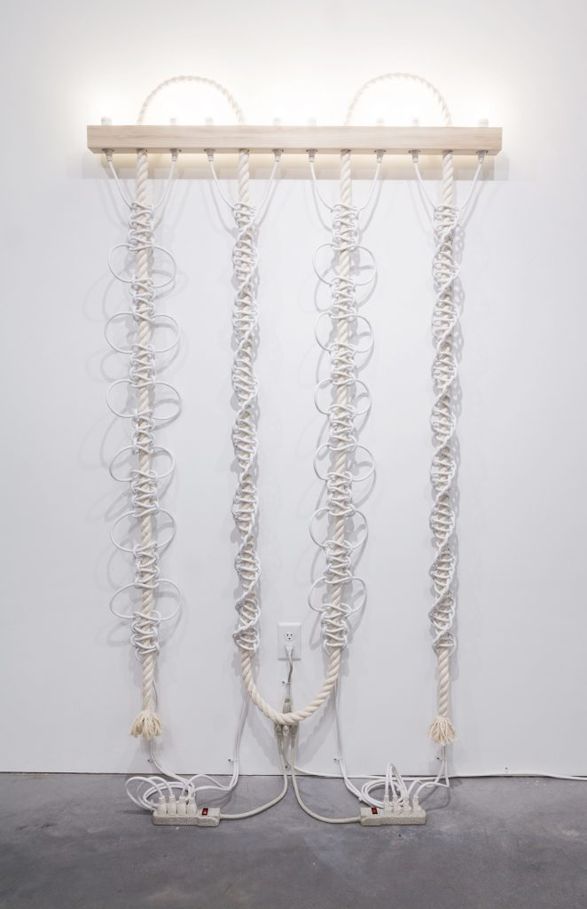 Dana Hemenway. Untitled (White Extension Cords, Rope), 2016; cotton rope, white extension cords, wood, compact fluorescent light bulbs, zip ties, power strips, paint; 77 x 48 x 3.5 inches. Courtesy of the artist and Eleanor Harwood Gallery, San Francisco.