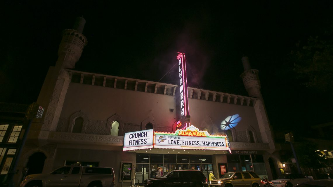 Exterior view of the Alhambra Theater / Crunch Gym with Light Installation by Elaine Buckholtz