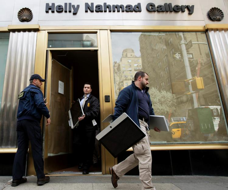 Federal agents remove computers from New York's Helly Nahmad Gallery located inside the Carlyle Hotel on April 30th, 2014. Courtesy of the Internet.