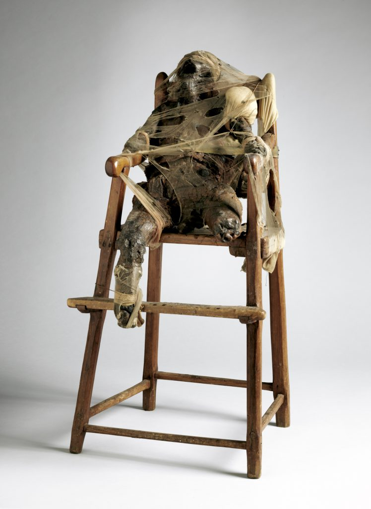 CHILD, 1959; wax, nylon, fabric, metal, twine, and wood high chair; 34 5/8 × 17 × 16 1/2 in. (88 × 43.2 × 41.9 cm); the Museum of Modern Art, New York, gift of Philip Johnson; © 2016 Conner Family Trust, San Francisco / Artists Rights Society (ARS), New York.