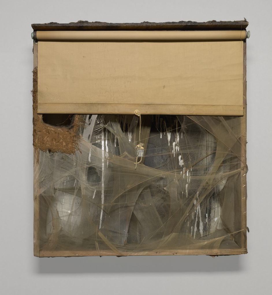 SPIDER LADY NEST, 1959; Wood box with aluminum paint, spray paint, window shade, nylon, thread, fabric, fur, lead customs seal on string, pearl bead, cotton ball, feathers, tassels, and cardboard; 31 x 28 1/2 x 7 in. (78.74 x 72.39 x 17.78 cm); Yale University Art Gallery, New Haven, Connecticut. Richard Brown Baker, BA 1935, Collection; © 2016 Conner Family Trust, San Francisco / Artists Rights Society (ARS), New York.