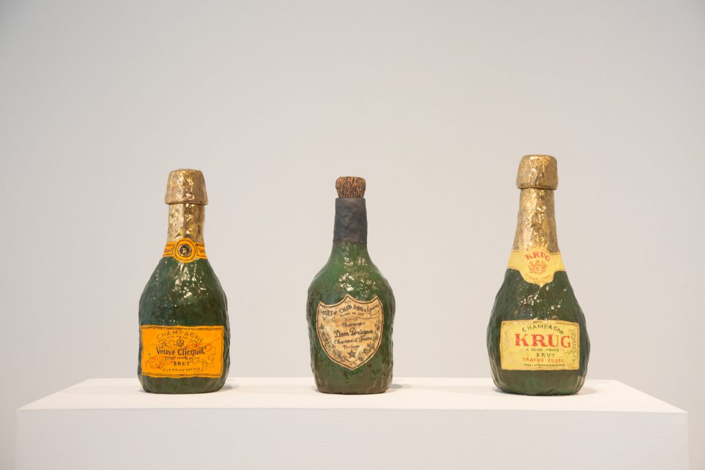 Veuve Clicquot; Krug; Dom Perignon, all 2016. Glazed porcelain, luster, and cork. Courtesy of A+E Studios.