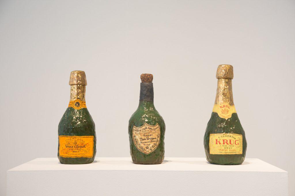 Veuve Clicquot; Krug; Dom Perignon, all 2016. Glazed porcelain, luster, and cork. Courtesy of A+E Studios.